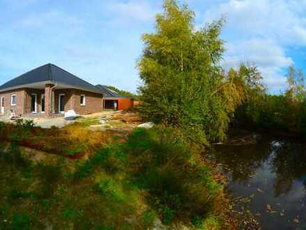 Neubau-Bungalow mit Kanalgrundstück, 133 qm Wf, 520 qm GS, 4 Zimmer, tolle Lage