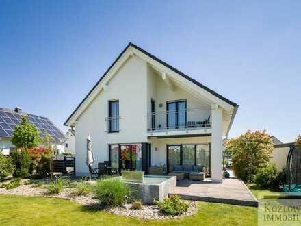 Design zum Wohlfühlen - Neuwertiges Architektenhaus in gefragter Familienlage!