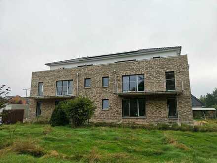 Zentrumsnah, barrierefrei, energieeffizient -Erstbezug 3-Zimmer-Wohnung- EBK, Gartenanteil, Garage