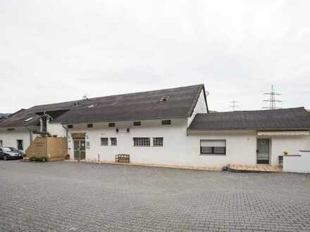 Vielseitiges Gewerbeobjekt mit 2 Wohneinheiten und Potenzial nahe Koblenz