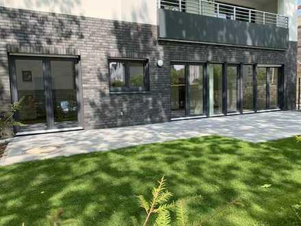 Haus im Haus! Exklusive Erstbezugs-Komfortwohnung mit großzügiger Süd-West-Terrasse und Gartenanteil