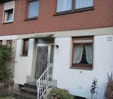 Ideal für Handwerker. unterkellertes Reihenmittelhaus mit Terrasse, Balkon, Garten und Garage
