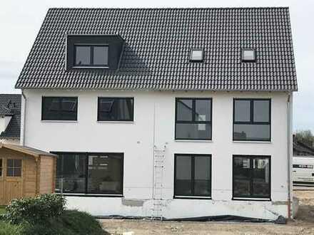 Neubau von einem attraktiven und modernen Reihenendhaus mit 160 m² Wfl. inkl. 400 m² Grundstück
