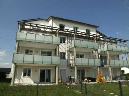 Erstbezug, gehobene und sonnige Dreizimmerwohnung mit großen Gartenanteil