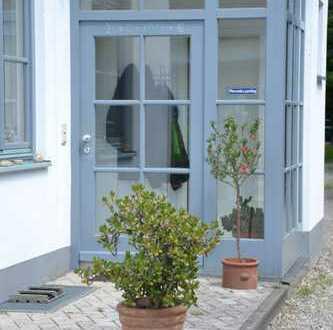 Großzügige DHH mit separater Einliegerwohnung und herrlichem Garten - in 35 Minuten in München