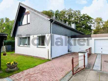Charmantes Einfamilienhaus mit attraktivem Dachgeschoss und Garten in vorteilhafter Stadtrandlage