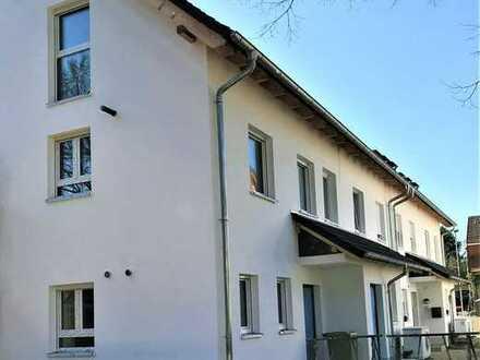Neubau KfW 55: Angesagte Souterrainwohnung mit großem Garten in zentraler Lage von Gaiberg