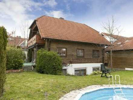 Einfamilienhaus mit Einliegerwohnung in ruhiger und sonniger Ortsrandlage