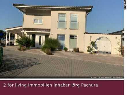 Wohnen und Arbeiten in einem luxuriösen Einfamilienhaus mit Gewerbemöglichkeit!