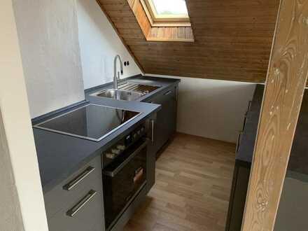 Erstbezug nach Sanierung mit Einbauküche: exklusive 3-Zimmer-Dachgeschosswohnung in Langen (Hessen)