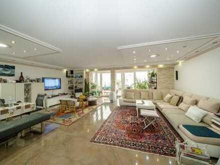 Exklusiv ausgestattete Erdgeschosswohnung mit Gartenanteil und Stellplätzen!
