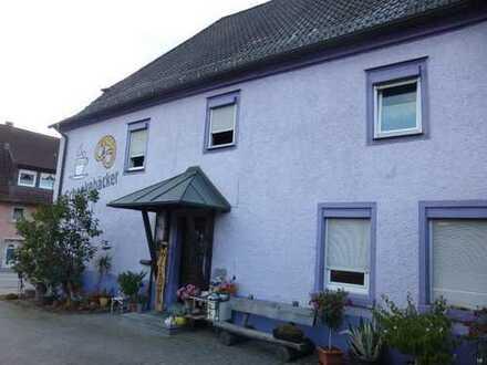 Mehrfamilienhaus mit Ladengeschäft und Bäckereigewerbe
