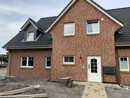 Erstbezug: attraktive 3-Zimmer-Terrassenwohnung mit Einbauküche und Balkon in Garding