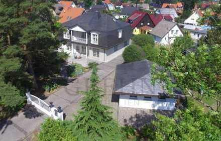Der Preis ist heiß: exklusive Villa mit 2 Garagen, Sauna, Kamin u.v.m.