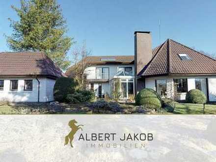 Exklusives Einfamilienhaus mit Einliegerwohnung auf parkähnlichem Grundstück in Saterland!