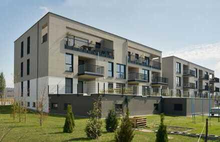Sonnige 3 Zimmer Wohnung mit kleinem Gartenanteil in hochwertigem, gepflegtem und ruhigem Neubau