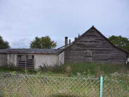 Abrissreifes Haus mit großem Grundstück zu verkaufen