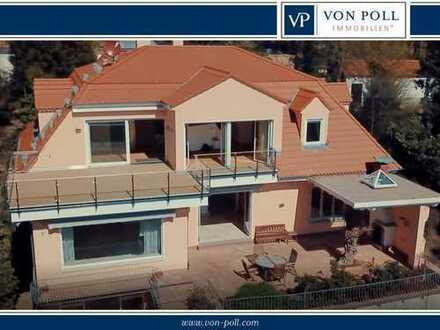 Großzügige Villa im mediterranen Stil mit Blick auf die Frankfurter Skyline