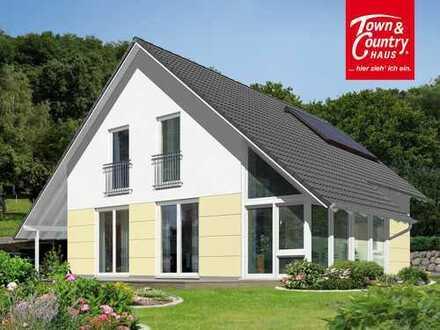Das Haus mit Luxus — Wintergarten und Carport im kommenden Neubaugebiet