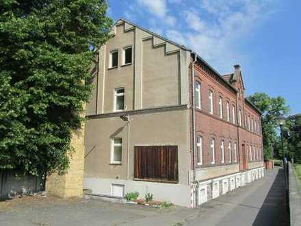 schöne Immobilie als Wohn- und Geschäftshaus zu verkaufen