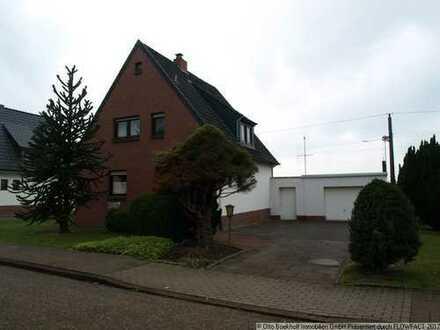Gemütliches Einfamilienhaus mit Garage und Werkstatt