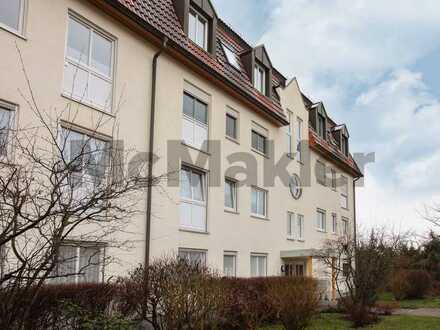 Zentrumsnah und grün: Pflegeleichte 2-Zi.-Dachgeschosswohnung mit TG-Stellplatz nahe Dresden