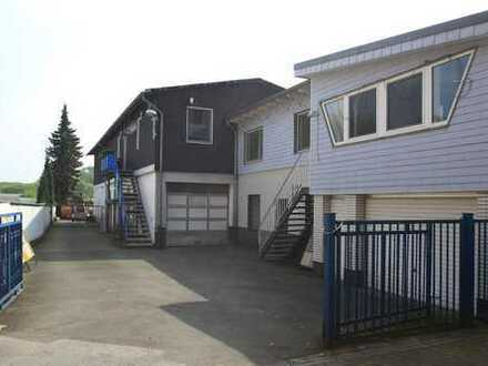 Mehrfamilienhaus mit Lager- Büro- und Freifläche