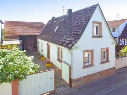 Einfamilienhaus mit ausbaufähiger Scheune, Innenhof und großem Garten!