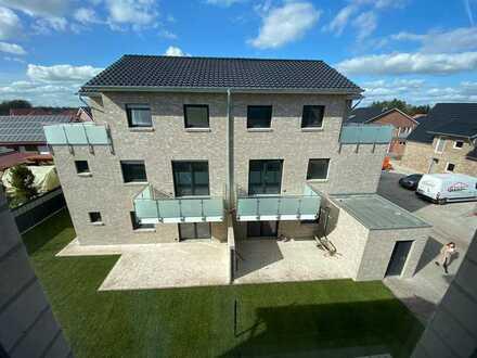 Neuwertige Wohnung mit drei Zimmern sowie Balkon und EBK in Saterland (Ramsloh)