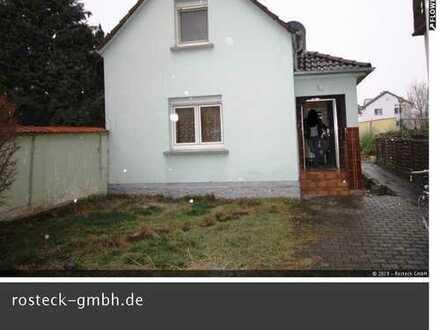 Kleines Einfamilienhaus mit zusätzlichem Bauplatz