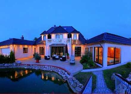 Einfamilienhaus mit Schwimmbad-,Büro/Einliegewohnung- und Doppelgarage