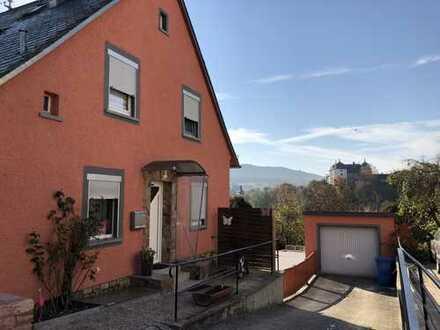 Doppelhaushälfte mit Garage, Terrasse, Garten & Schloßblick in 55490 Gemünden