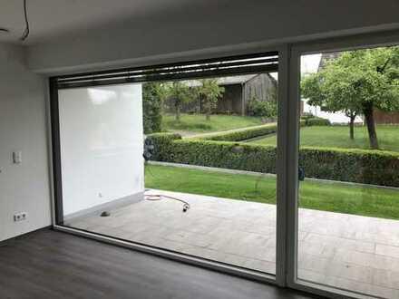 GIS IMMOBILIEN - Exklusive Luxus-Wohnung in modernem Architektenhaus mit Terrasse und Garten