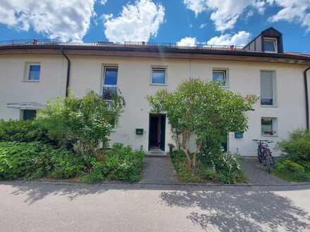 Ansprechendes, großes und sehr helles Mietshaus mit Garten in Unterbiberg