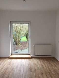 Großzügige und sehr charmante 3 Zimmerwohnung mit Garten in Brake