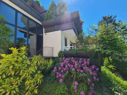 Ansprechende, frisch renovierte Eigentumswohnung mit großer Terrasse und Garage in MH- Toplage!