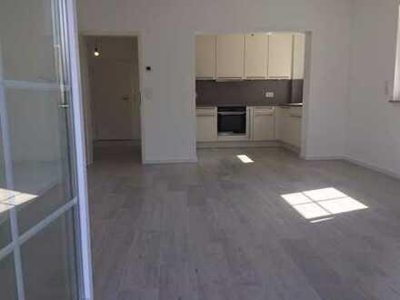 Erstbezug: Stilvolle 3-Zimmer-Wohnung mit Einbauküche, Terrasse und Garten in Hoppegarten
