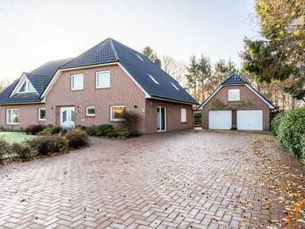 Großzügiges Einfamilienhaus mit Waldbestand und separatem Praxisgebäude in Nortmoor!