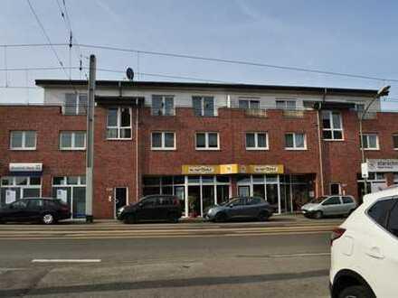 Helle Laden-/Bürofläche in modernem Wohn- und Geschäftshaus