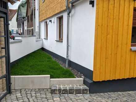 Schuch Immobilien - Exklusive Neubauwohnung in romantischer Hofreite in Liederbach