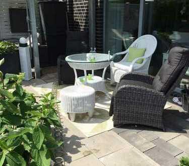 Neuwertige und großzügige 3-Zimmer Terrassenwohnung mit Gartenanteil!