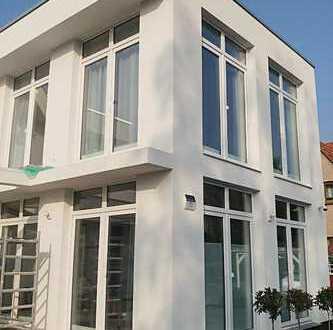 Wohnung im DHH-Stil inkl. eigener Garten! Wohnen in grüner, ruhiger Seitenstraße!