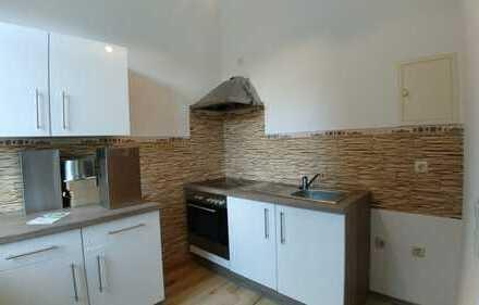 2-Raum mit offener Küche und Einbauküche