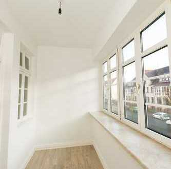 Man wird Sie beneiden - top sanierte 4-Zimmerwohnung mit Wintergarten!