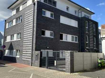 """Seniorengerechte 2 Zimmer Erdgeschoss-Wohnung mit Terrasse und Duplex-Parker """"mitten"""" in Moers."""