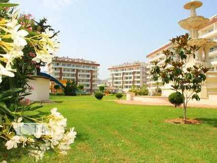 Preiswerte, neuwertige 3-Zimmer-Wohnung mit Balkon und EBK mit Strandnähe in Alanya-Demirtas