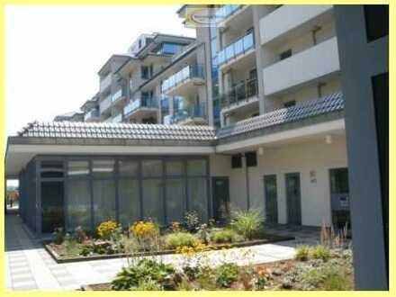 Luxuriös eingerichtete zwei Zimmerwohnung mit großem Balkon in direkter Rheinlage