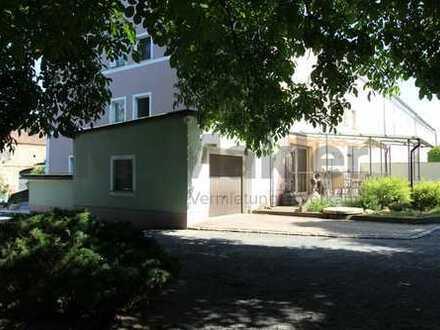 Schöne Erdgeschosswohnung mit 5 Zimmern und großem Garten in ruhiger und familienfreundlicher Lage!