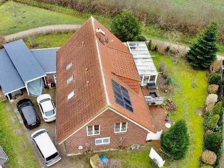Einfamilienhaus mit Einliegerwohnungen, Carports und Wintergarten in bevorzugter Lage in Bad Bramste