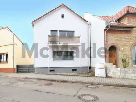Moderner Familien-Wohntraum direkt am Rhein: Lichtdurchflutetes 5-Zi.-EFH mit Garten